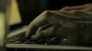 stock-footage-close-up-of-hands-typing-on-a-computer-keyboard