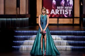Taylor-Swift-speaks-onstage-during-The-57th-Annual-GRAMMY-Awards-at-the-STAPLES-Center[1]