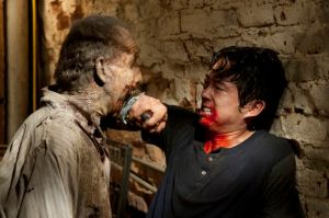 Glenn (Steven Yeun) and Walker - The Walking Dead - Season 3, Episode 7 - Photo Credit: Gene Page/AMC
